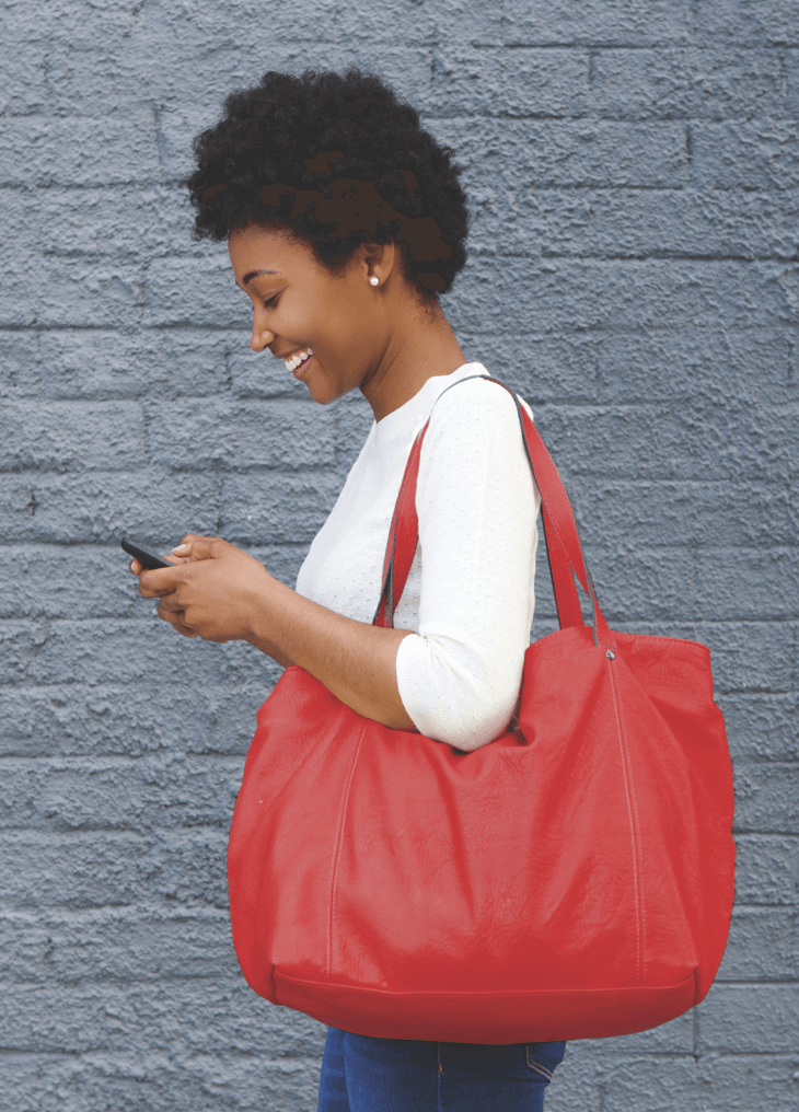 Woman smiling while using mobile device