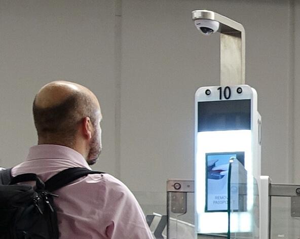 Man at facial recognition machine